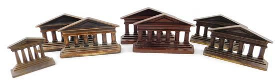 Seven 20th C. cast-iron bookends depicting Greek temple facades, each with six Doric columns, blank pediment, and tiered steps, including three similar pairs and one single, all with bronzed finish