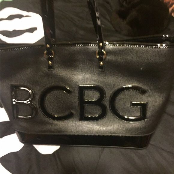 BCBG BAG Very nice BCBG bag very large and roomy black bag only been used twice no use of any were BCBG Bags Totes