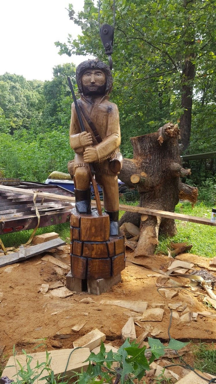 Chainsaw carved pioneer by collins carving chainsaw art