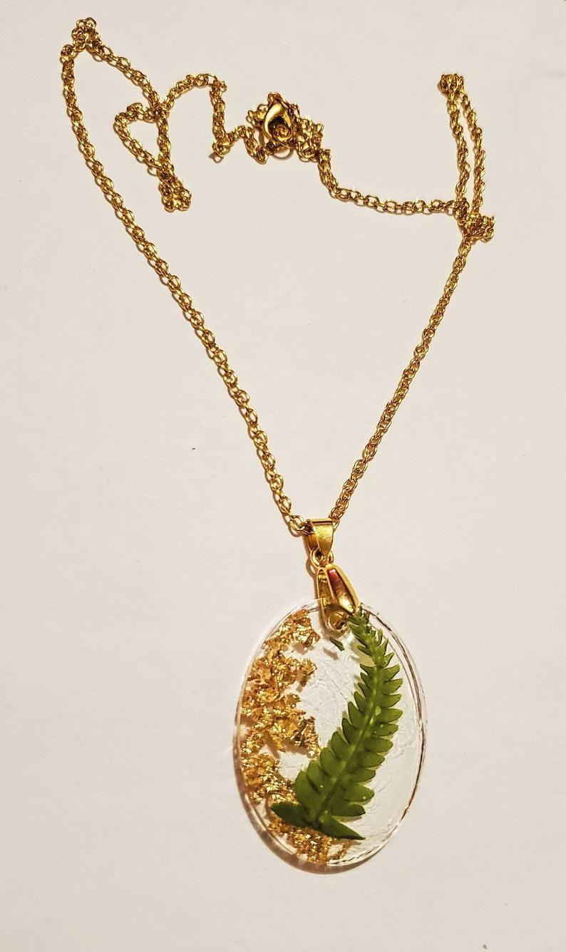 Oval gold leaf resin pendant earrings