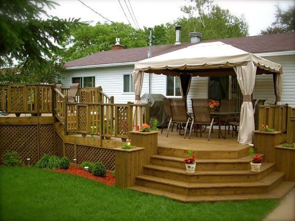 deck built into backyard hill
