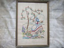 Old vintage embroidered picture of Girl in Flower  Garden