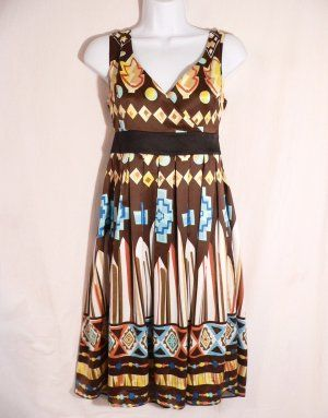 Shades of brown make this Indian motif fabric look so inviting! A Very cute sun dress!