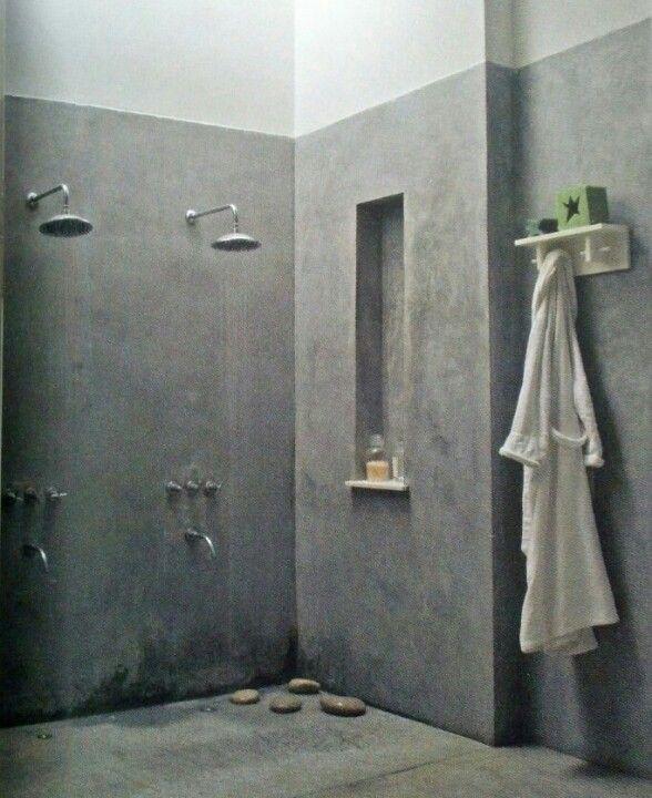 Concrete Bathroom Floor: Concrete Shower, Double Head And Rocks On The Floor