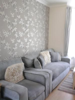 Feature wall feature walls pinterest floral for Taupe wallpaper living room