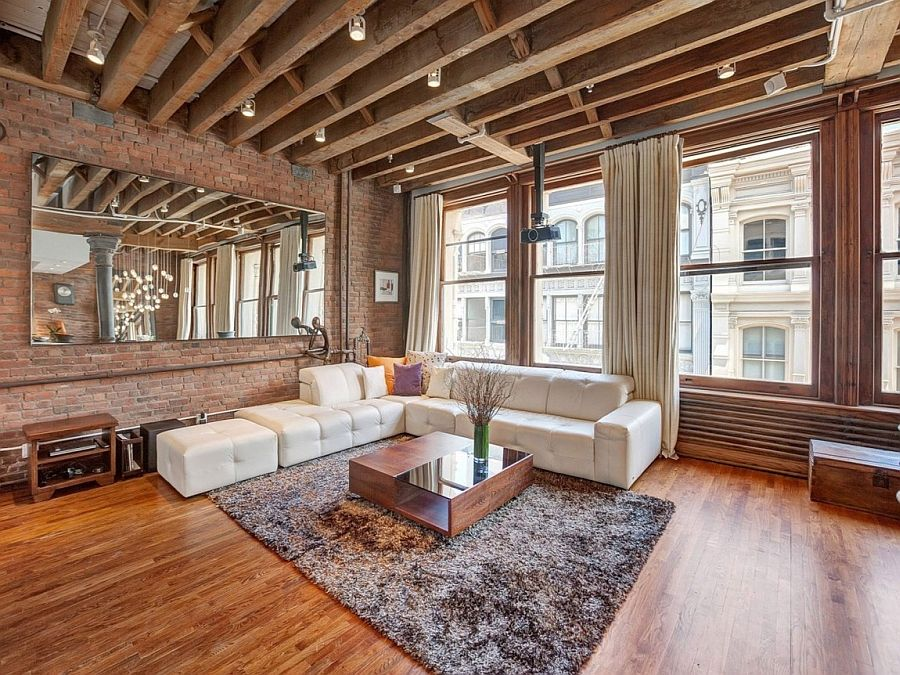 Spacious Living Room Of The Nyc Loft In Wood And Brick Cozy New York City Loft Enthralls With An Eclect Loft Apartment Decorating Brick Living Room Loft Design