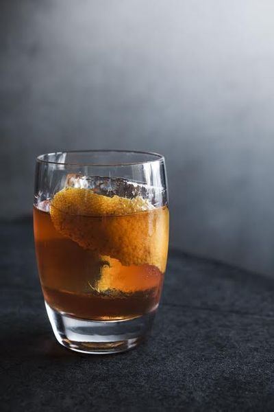 The Perfect Old Fashioned 2 ounces overproof rye or bourbon 1/2 ounce simple syrup 2 dashes Angostura bitters Orange twist  Combine whiskey, simple syrup and bitters in a cocktail shaker with ice. Stir then strain into old fashioned glass with ice. Garnish with orange twist.