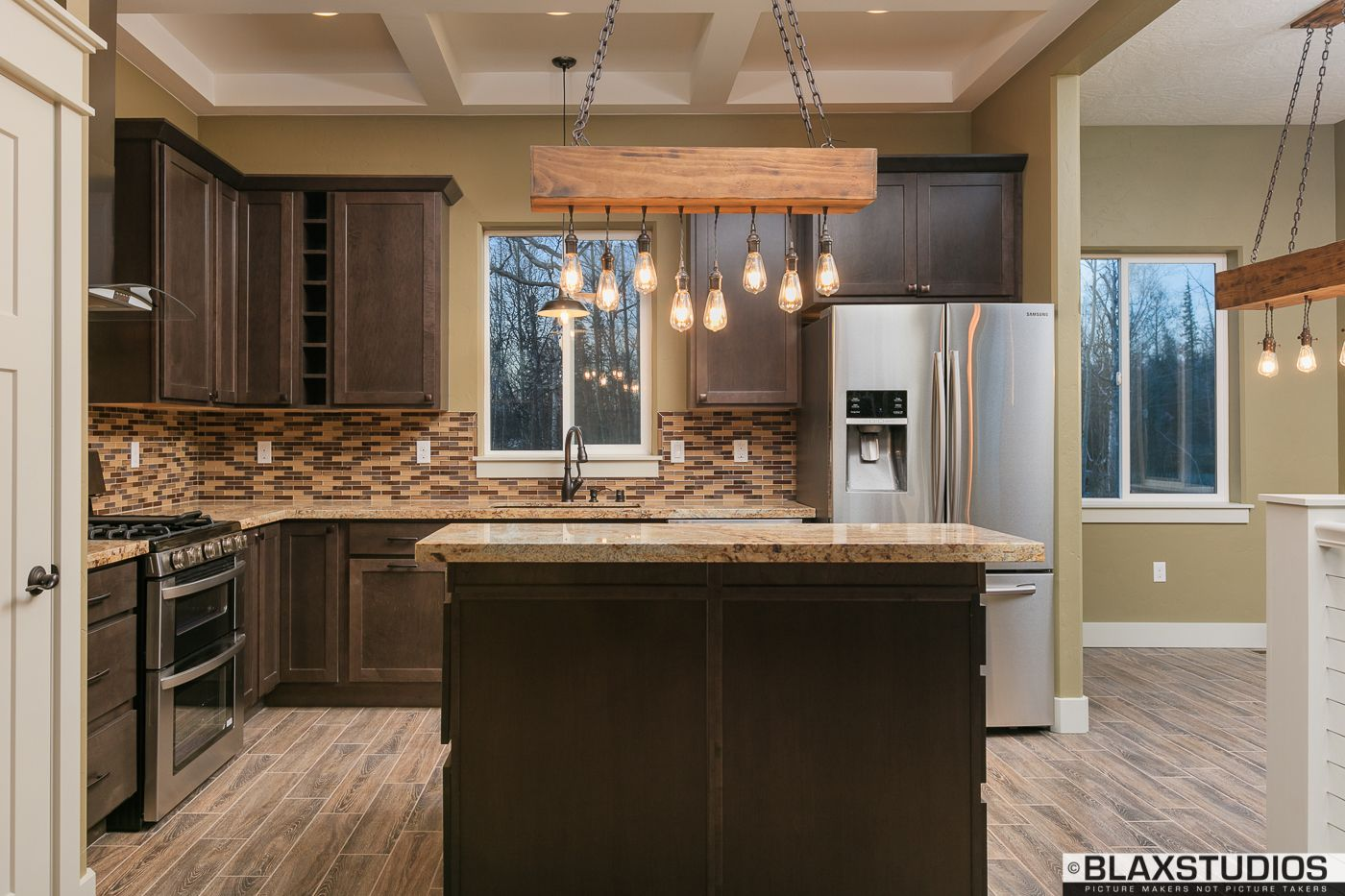 thatch kitchen, granite, diamond cabinets, edison lights, & rustic chandeliers.   sheremet homes