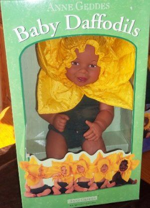 """Anne Geddes 15"""" African American Baby Daffodils Doll by Unimax Toys. $35.00. This adorable doll was inspired by the photographs of children taken by Anne Geddes. Children will love snuggling right up to Baby Daffodil Doll -- she is so cute, loveable and soft in her cuddly flower costume. Measures 15"""" tall.. Realistic adorable baby face. Recommended for age 18 months and older. Collector's series. Bean filled plush doll. Baby Daffodil: even the name is precious. ..."""