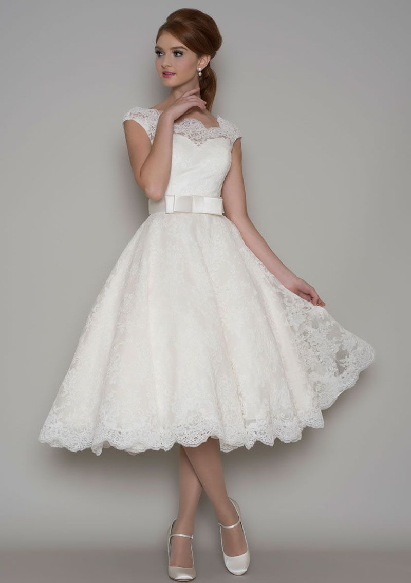 This Vintage Tea Length A Line Wedding Dress Features Strapless Sweetheart Underskirt Skirt With Illusion Sheer Lace Overlay Cap Sleeves Matching