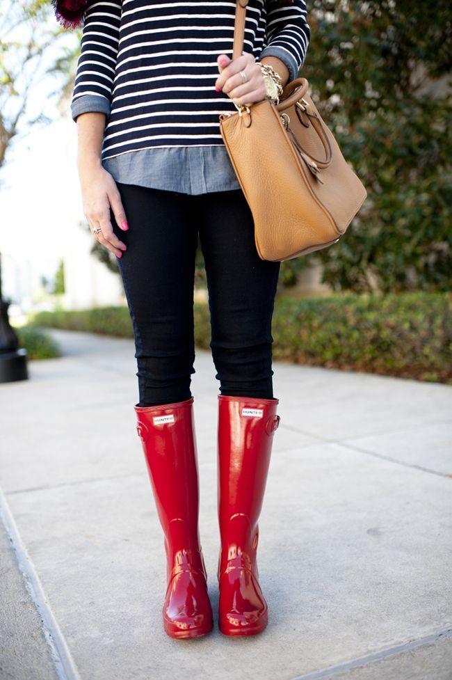 Red rain boots, black pants, striped