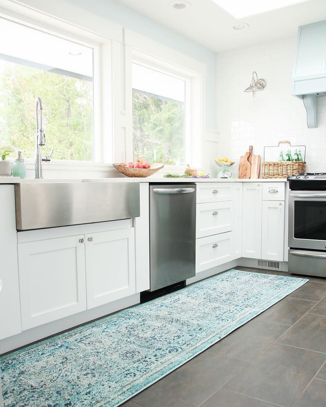 Kitchen sink window decor  try adding a colorful runner in your kitchen for an added element of