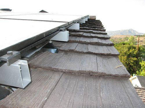 Solar cell shingles for houses. http://www.domestic-solar-panels.info/solar-panel-shingles.html house 021