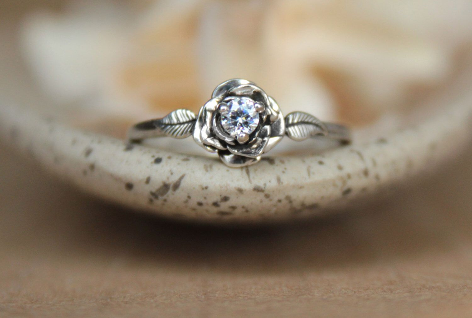 Delicate Rose Engagement Ring with White Sapphire in Sterling - Silver Unique Rose Diamond Alternative Promise Ring, Commitment Ring by moonkistdesigns on Etsy https://www.etsy.com/listing/233012240/delicate-rose-engagement-ring-with-white