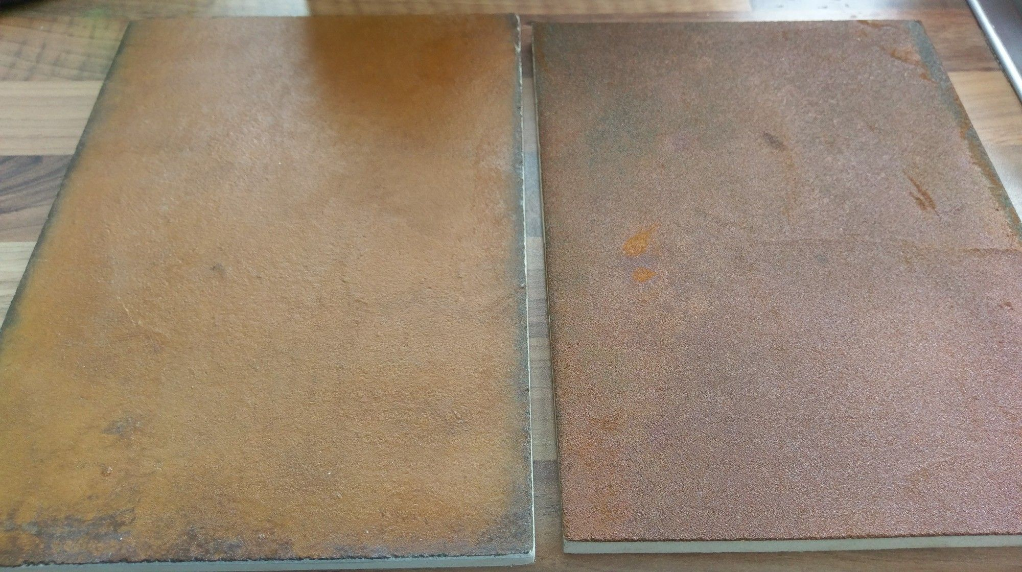 Rust oxide microcement sample boards by Wallstothefloor com