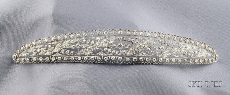 Edwardian Platinum and Diamond Bandeau, c. 1915, the flexible form bezel and bead-set with old European and old mine-cut diamond melee