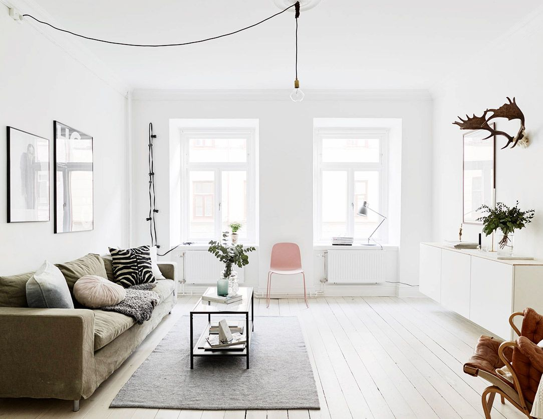 Visit a small swedish flat with charming modern