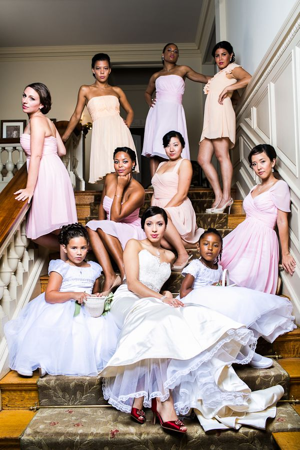 bride and bridesmaids in a dramatic vanity fair style shot on mansion stairway. Image taken at Cairnwood Mansion near Philadelphia by Ben Weldon of Weldon Weddings.