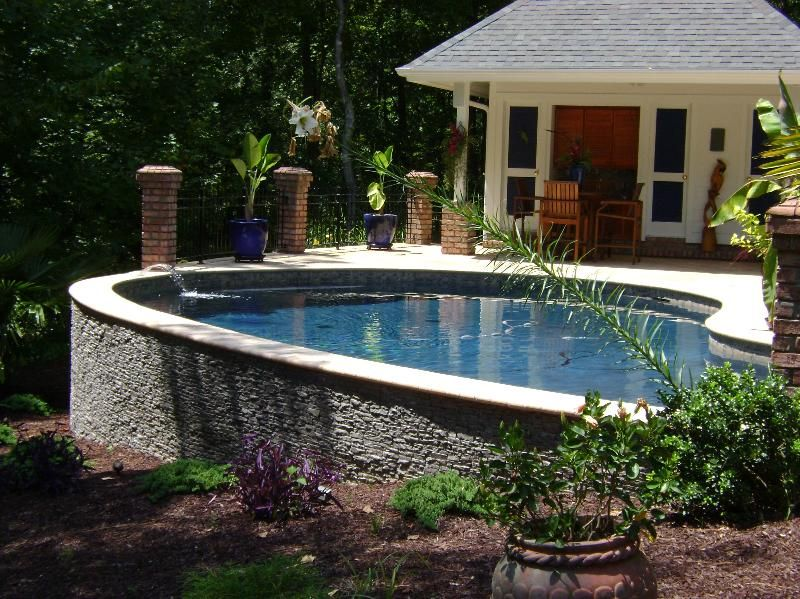 Pools with stone walls residential swimming pool renovations pool ideas pinterest stone for Swimming pool renovation ideas