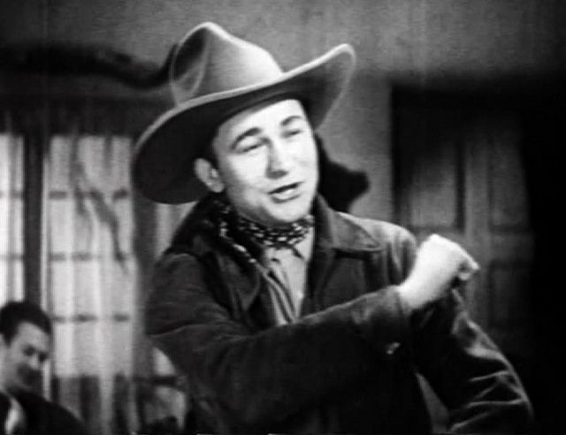 Tex Ritter, singing Movie star in B Westerns Trouble in Texas 1937)