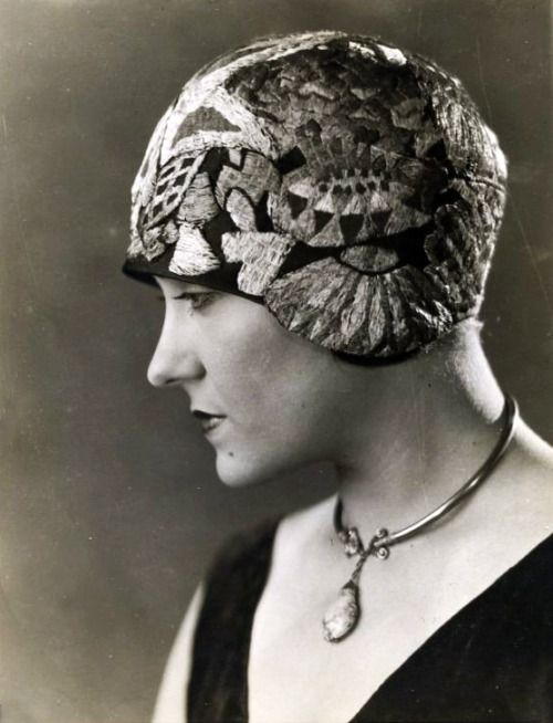 Gloria Swanson wearing an amazing cloche hat with Art Deco inspired embroidery.