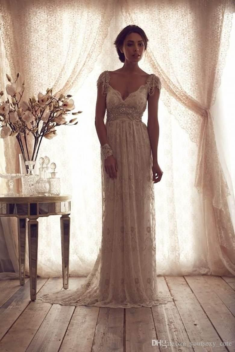 2016 vintage beach wedding dresses deep v neck cap sleeves for Vintage beaded lace wedding dress