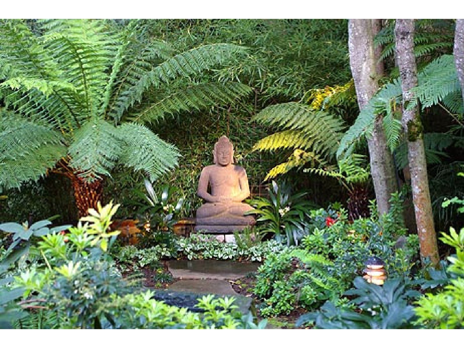 Buddha statue in garden setting landscaping garden for Garden pool zen area