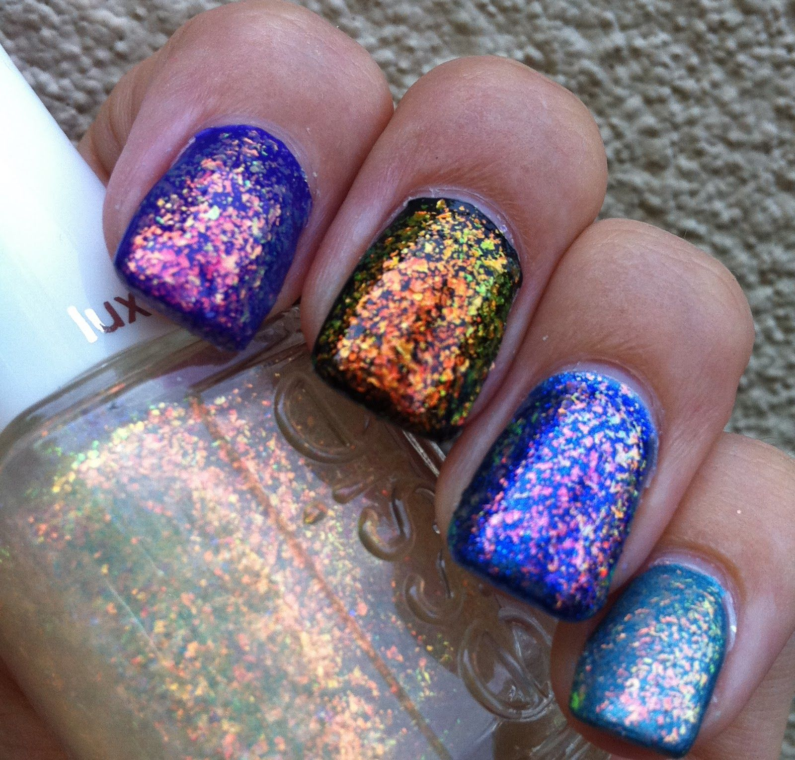 Essie Shine of the Time layered over different coloured polish ...
