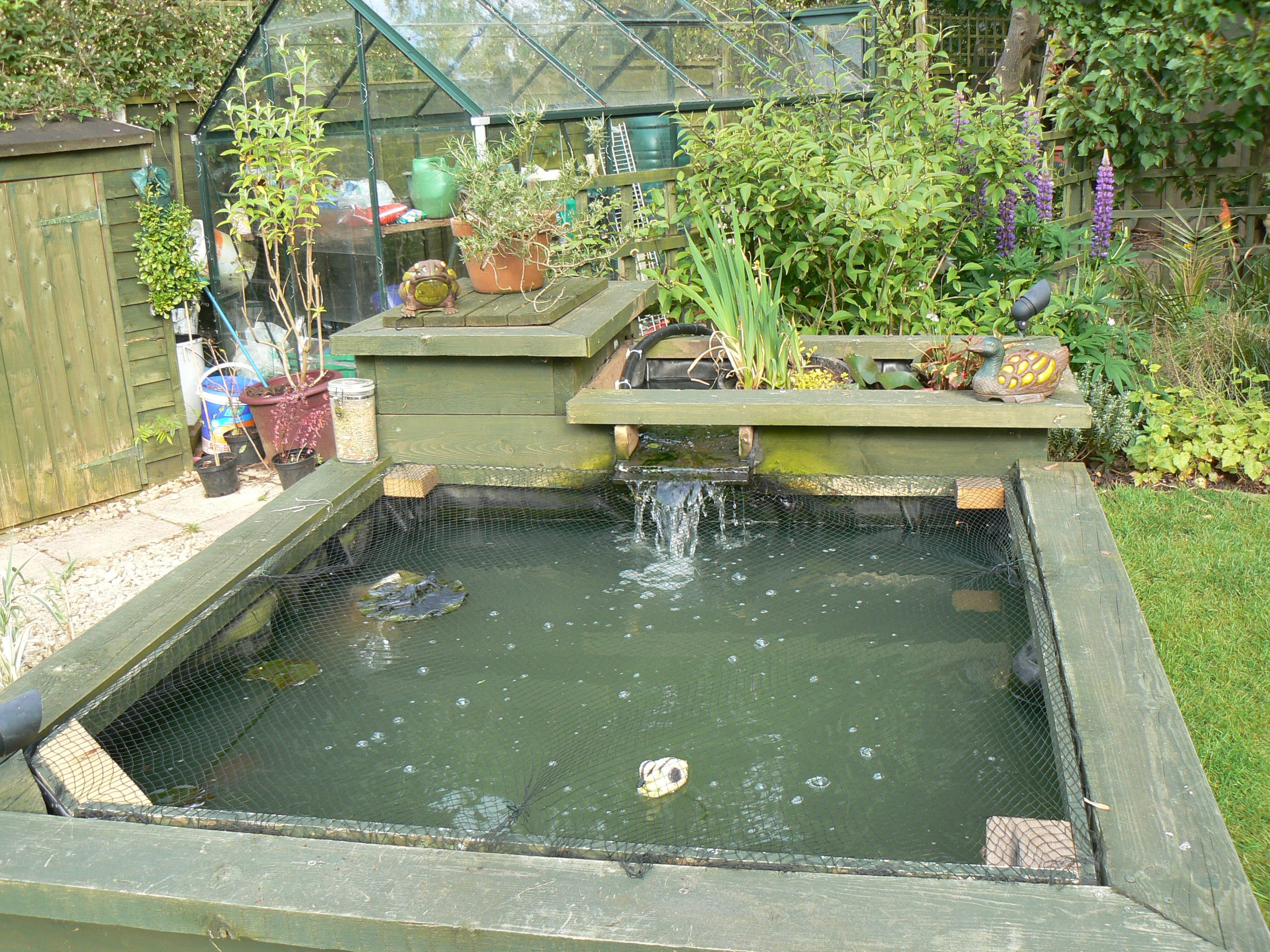 Johnson close 2009 raised sleeper pond with water cascade for Outdoor fish pond filter