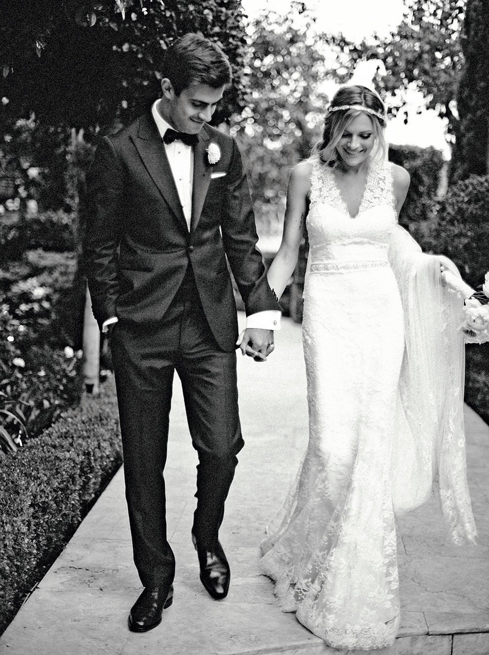 For good luck, the bride—in a Maria Elena headpiece with Monique Lhuillier gown and belt. #weddings