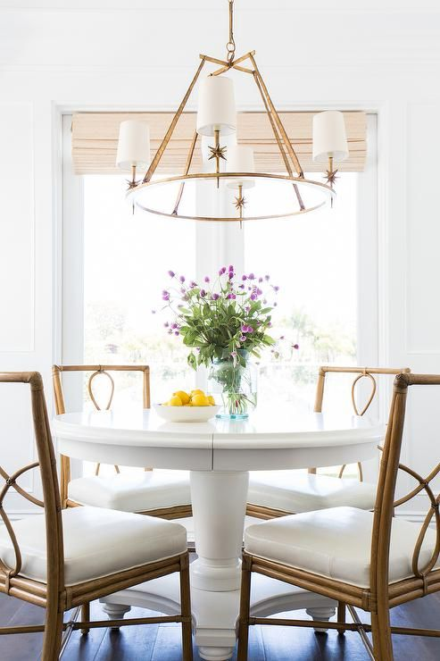 White Round Dining Table With Bamboo Dining Chairs Transitional
