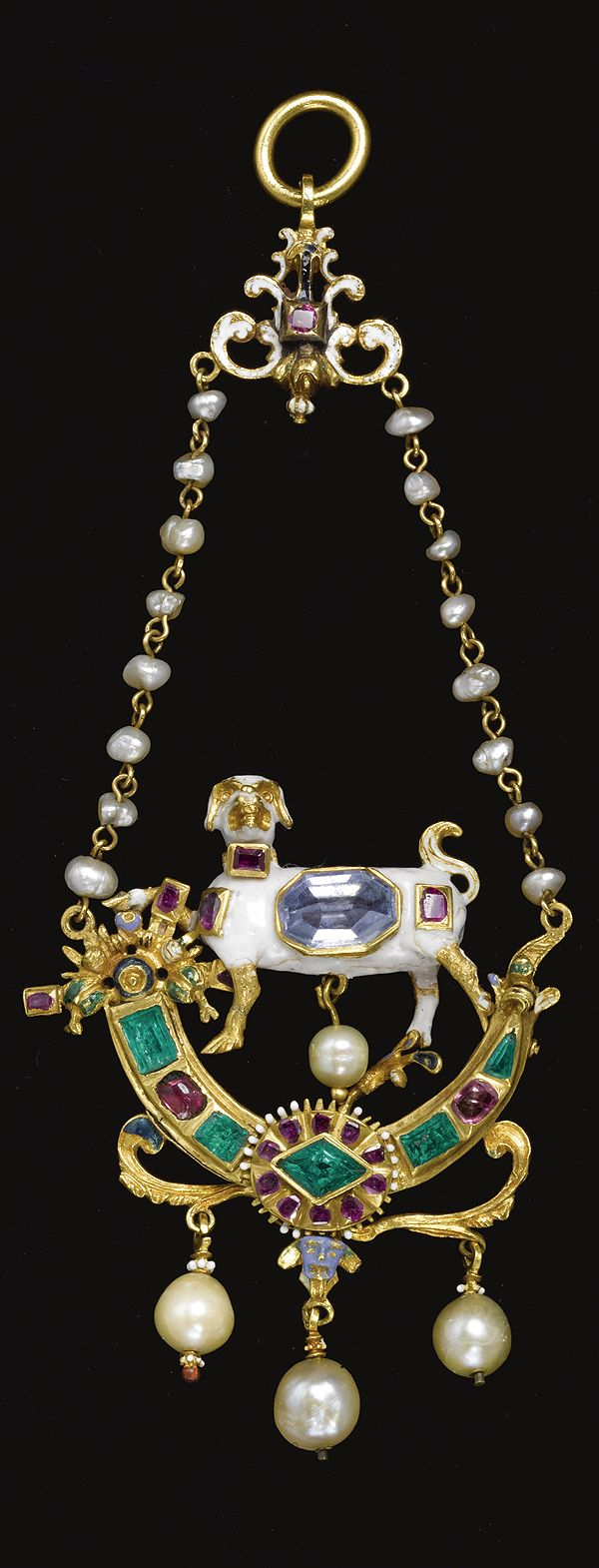 A Renaissance style diamond-, ruby- and emerald-set, enamelled gilt silver-mounted and pearl pendant. centered by a dog. 5 in. including chain; 12.7 cm.