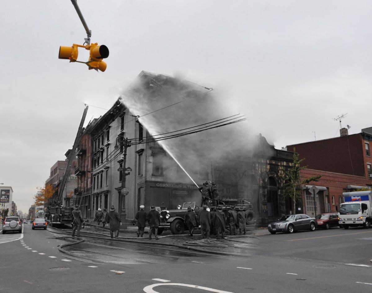 Firefighters fought a blaze at Grand St. and Kent Ave. in Williamsburg from the street as well as adjoining rooftops on February 16, 1946.