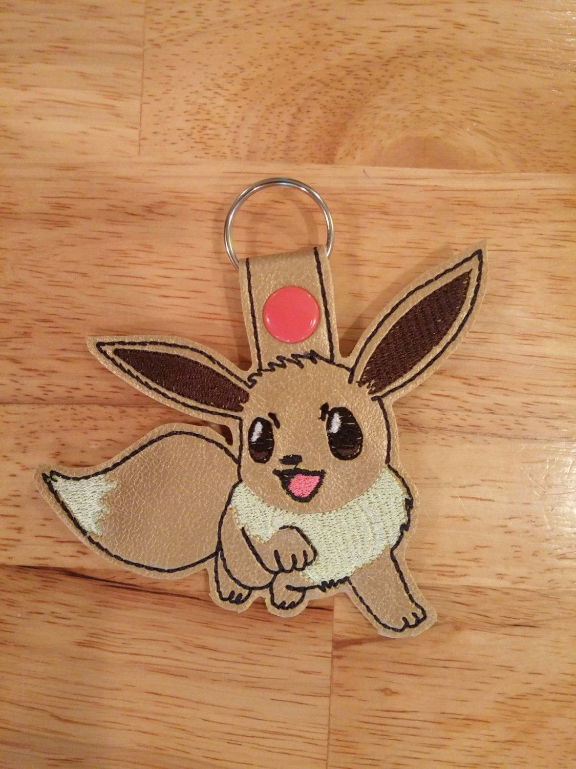 A personal favorite from my Etsy shop https://www.etsy.com/listing/470093475/eevee-pokemon-inspired-snap-tab-key-fob