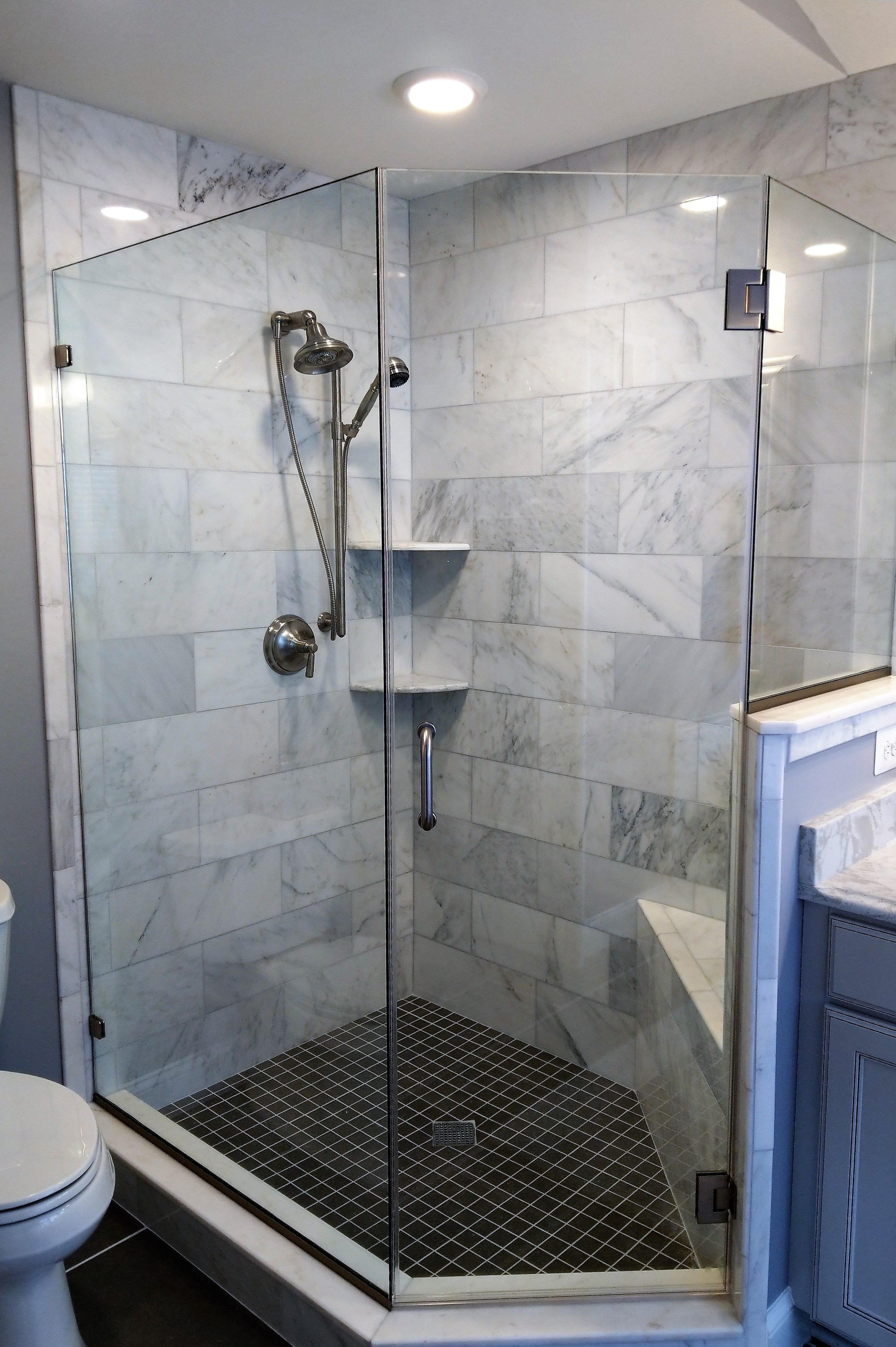 Frameless Enclosure With Custom Angles And Glass To Glass Hinges