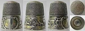 """Simons St. Louis World's Fair.  Photo property of Kit Froebel, thimblescope.com, from article, """"Antique Thimbles, American Style"""" on AntiqueTrader.com."""