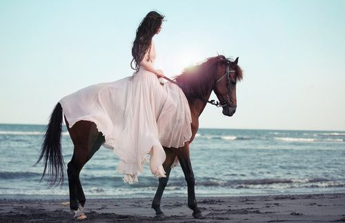 sidesaddle with long flowing dress