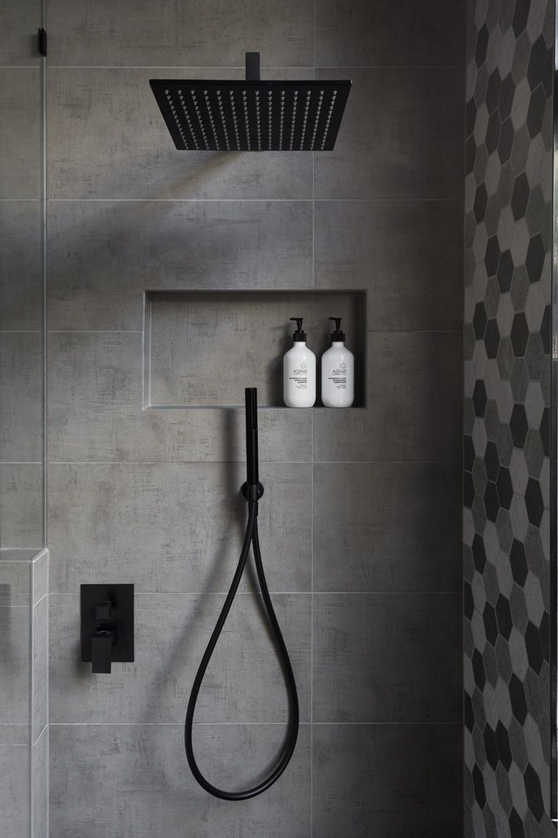 In This Modern Bathroom, The Shower Has A Matte Black Rainfall Shower Head  And A Hand Held Shower Head, As Well As A Tiled Built In Shelf.