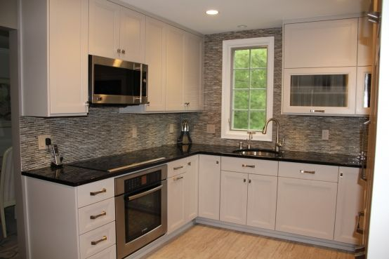 This kitchen by Elite Kitchens features 12x24 Monticello Grigio porcelain on the floor and Lines Shades Glass Mosaic on the Backsplash.  What a great combination! ...