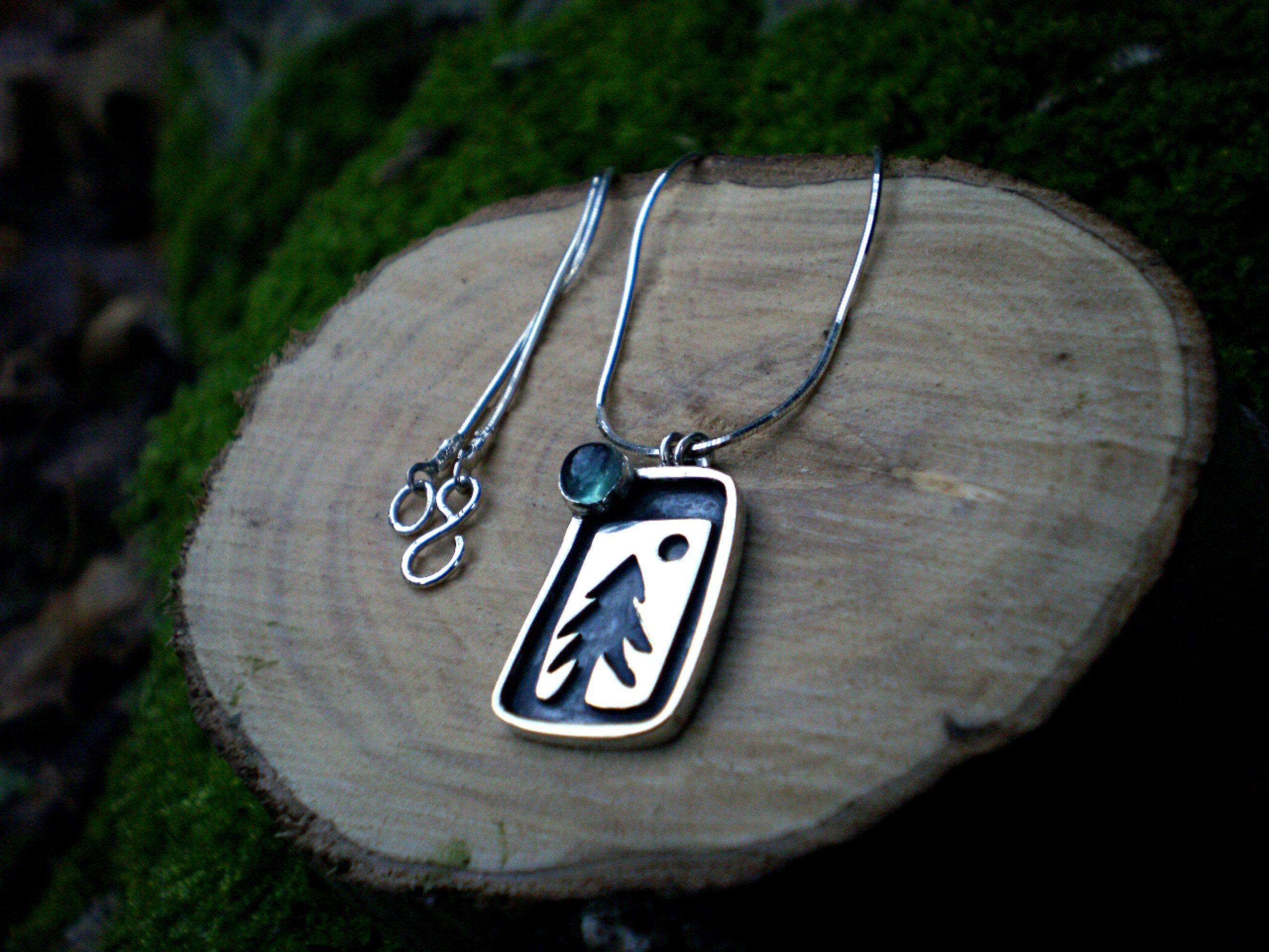 Oxidized silver pendant aztec style with gold eye