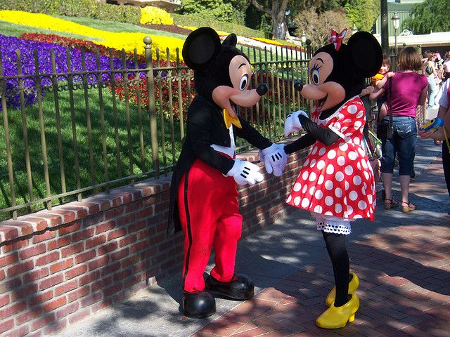 Mickey and Minnie in front of Disneyland