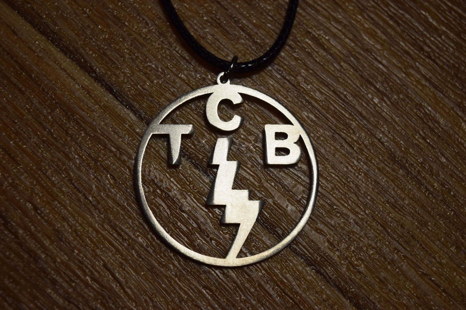 Taking care of business elvis presley tcb necklace pendant symbol taking care of business elvis presley tcb necklace pendant symbol guo guo s talisman choker mozeypictures Gallery