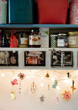 a little Christmas under the cabinet