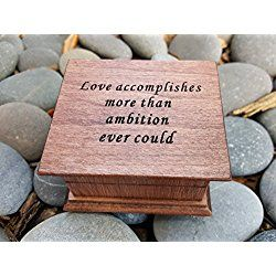 Custom made music box with quote: Love accomplishes more than ambition ever could with your choice of color and song