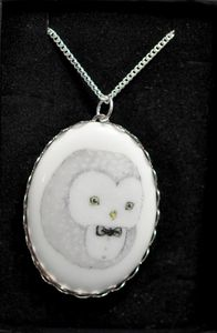 What a darling owl in a bow-tie. Love the semi-cameo look, and I'd much rather sport a cute puff-ball like this than some dead Victorian lady.