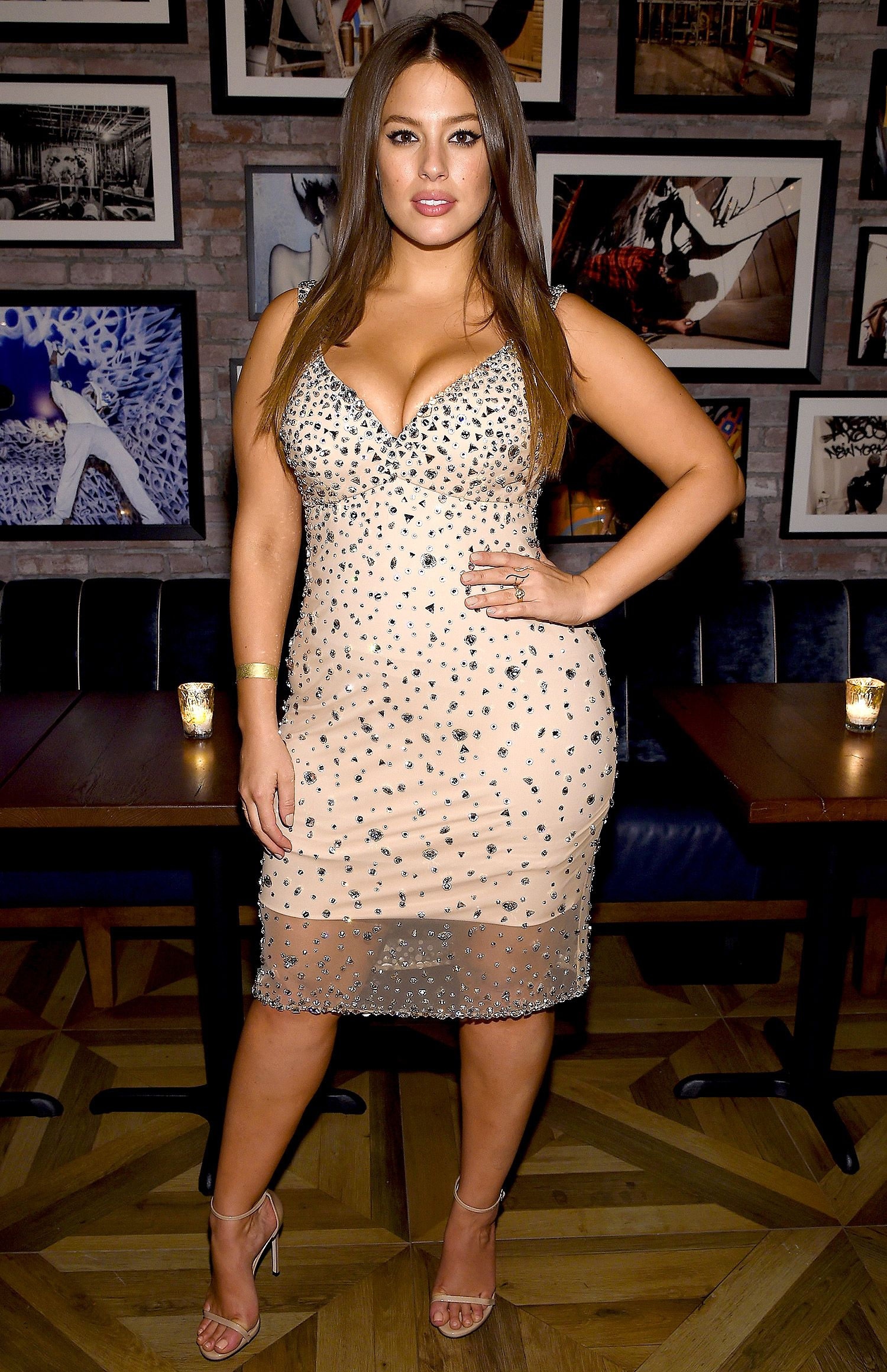 cd8fa594182fca ASHLEY GRAHAM in a nude body-hugging CD Greene cocktail dress with all-over  sparkle appliqué at a IMG Models event celebrating her Sports Illustrated  ...