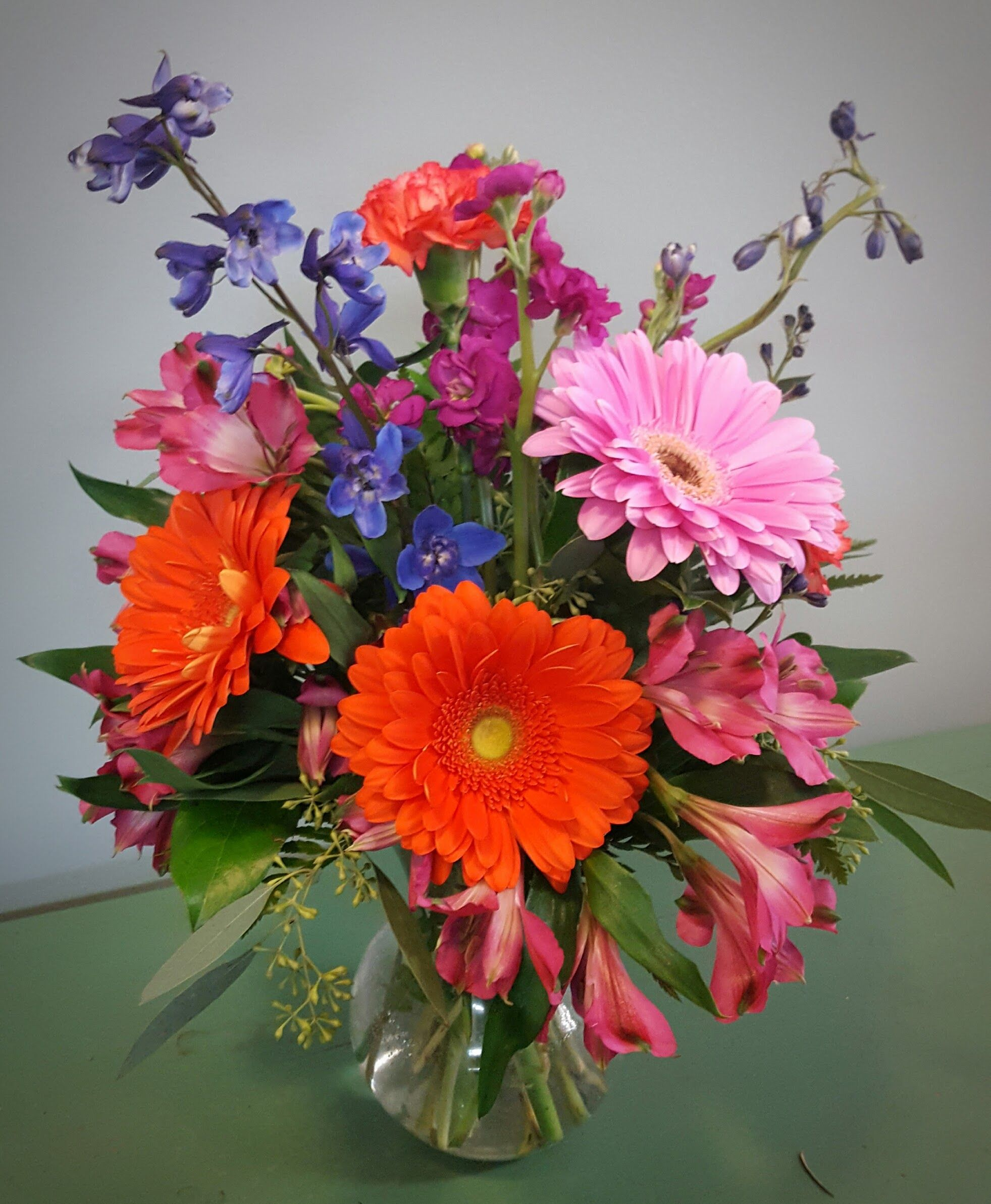 Fun for all occasions! This flower vase arrangement is bursting with ...