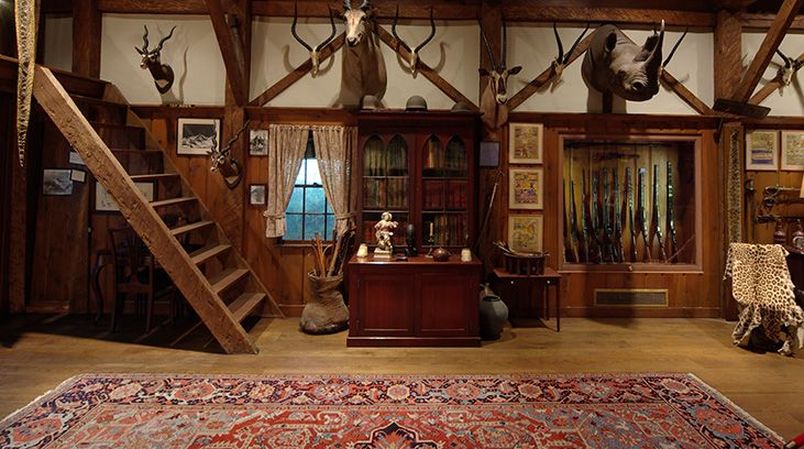 exhibits_colby-room_stairs-and-rifles.jpg (731×408) | Trophy Room ...