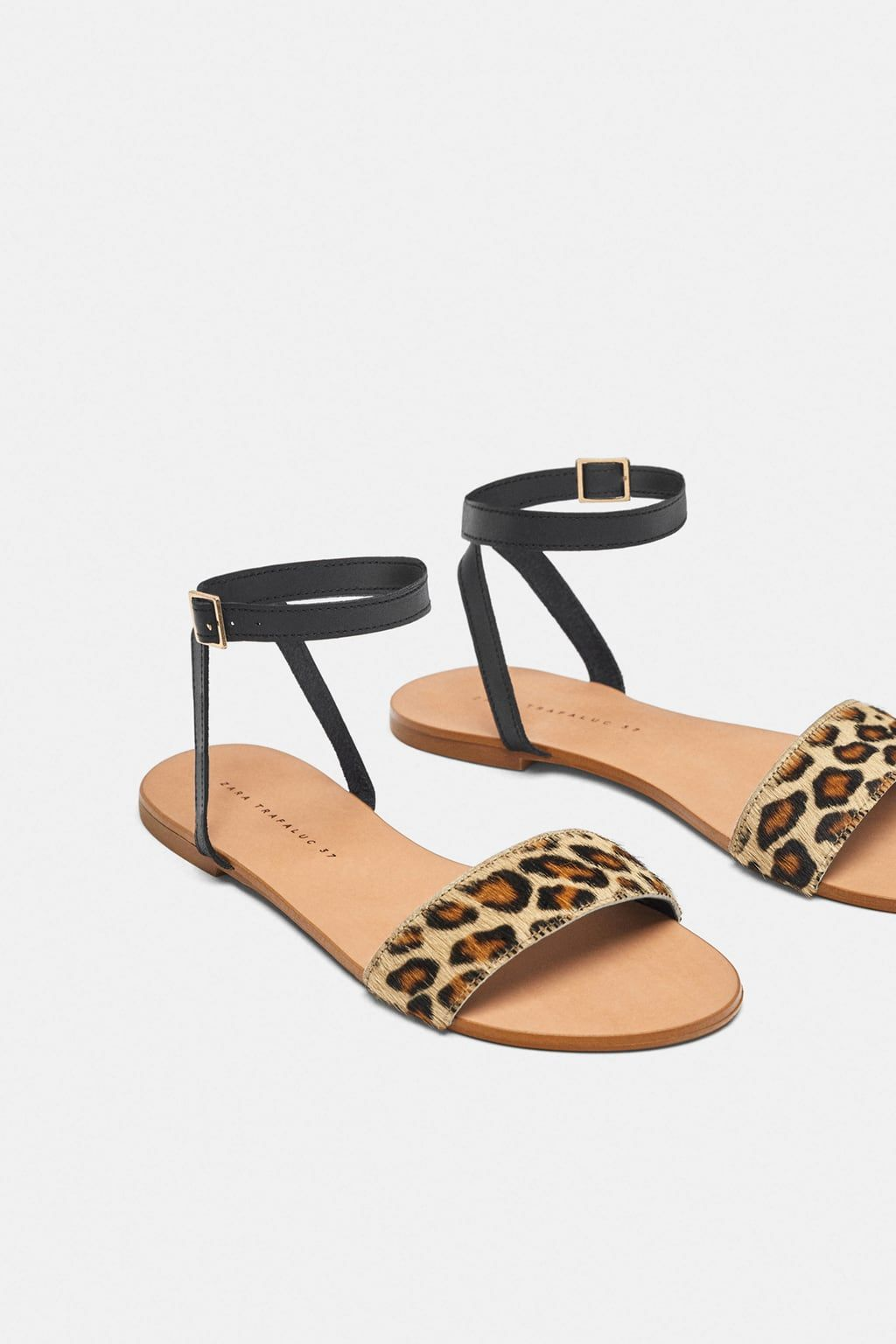 206f7bbd340 Image 1 of FLAT LEATHER SANDALS WITH LEOPARD PRINT STRAP from Zara