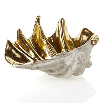 Natural and organic, then adds stunning glamorous Gold to exclusive Atlantis Clam Shell. The shell is molded to perfectly resemble the color and detail of a Giant Clam, then is given an interior of brilliant Gold leaf for an outstandingly elegant look.